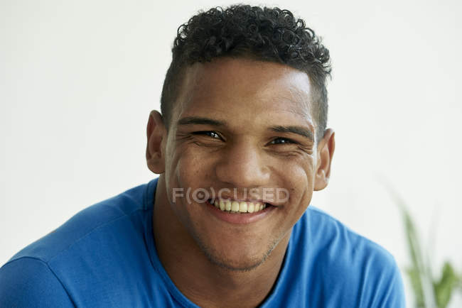Portrait of smiling brazilian man — Stock Photo