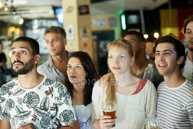 Soccer fans watching match together at pub — Stock Photo