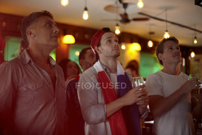 French soccer fans watching match in bar — Stock Photo