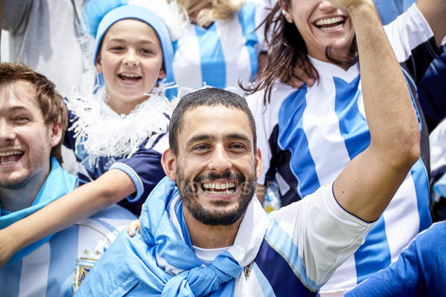 Argentinian football fans cheering at match — Stock Photo