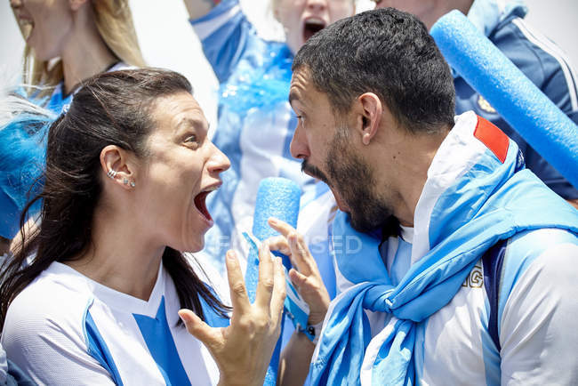 Argentinian football fans shouting excitedly at match — Stock Photo