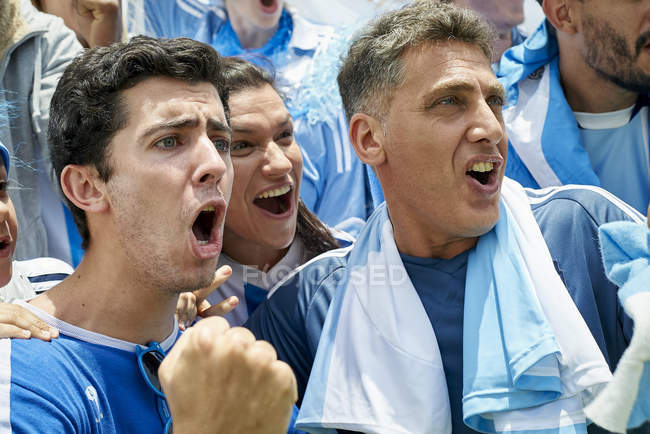 Argentinian football fans watching football match — Stock Photo