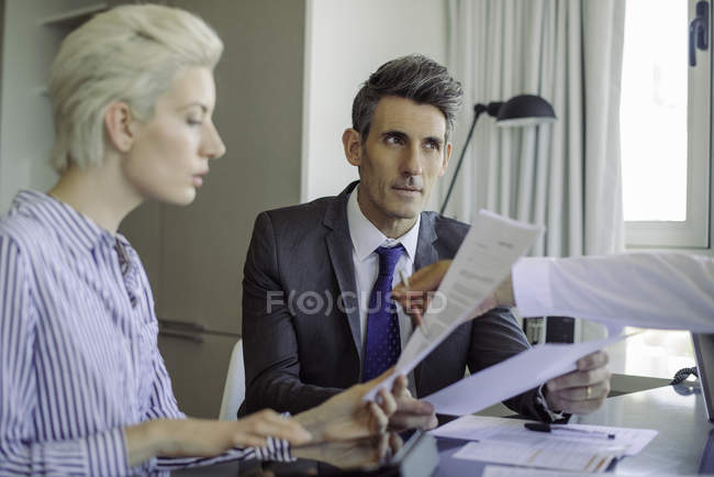 Man and woman reviewing document in the office — Stock Photo