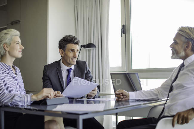 Mature businessman meeting with clients in the office — Stock Photo