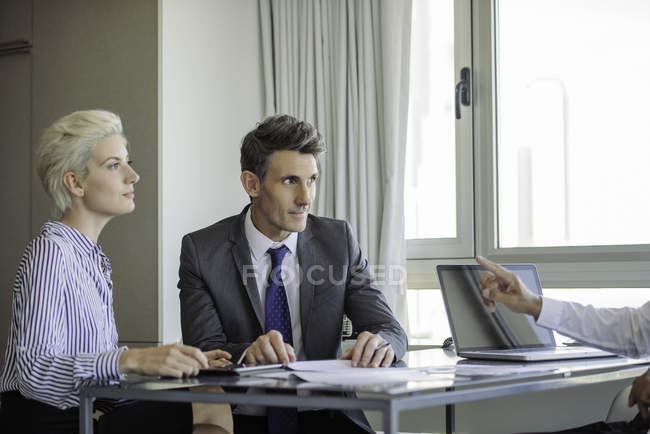 Man and woman meeting with mature businessman — Stock Photo