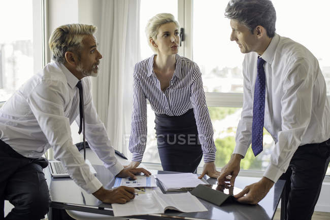 Colleagues working together in office — Stock Photo
