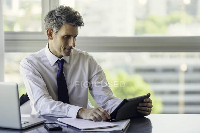 Man using digital tablet in office — Stock Photo