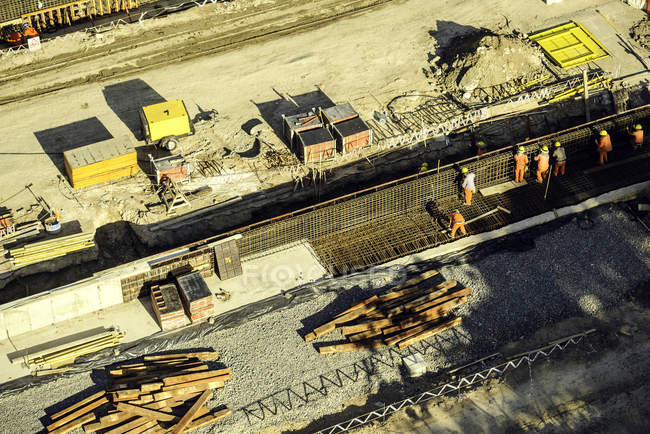 Aerial view of workers in hardhats at Construction site — Stock Photo