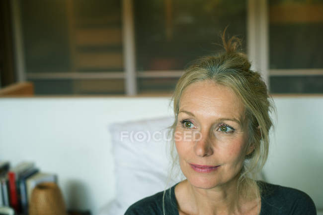 Portrait of Mature woman looking away at home — Stock Photo