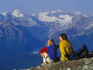 Man sitting with son in mountains — Stock Photo