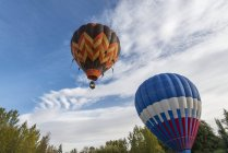 Flying air balloons with cloudy sky — Stock Photo