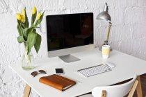 Minimalistic monoblock PC on table — Stock Photo