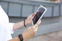 Female hands holding digital tablet — Stock Photo