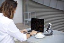 Woman typing on laptop keyboard — Stock Photo