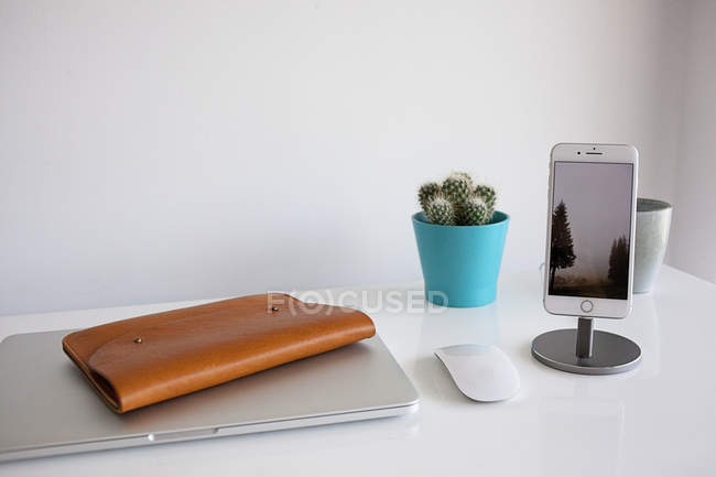 Workplace with closed laptop — Stock Photo