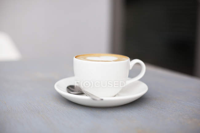 Cup of aroma coffee with foam — Stock Photo