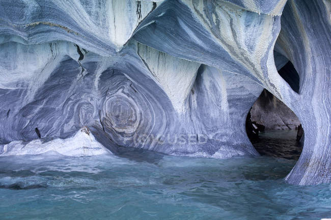 Inner sea cave view with colorful mineral formations — Stock Photo
