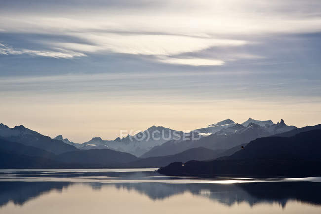 Landscape with mountains peaks and lake — Stock Photo