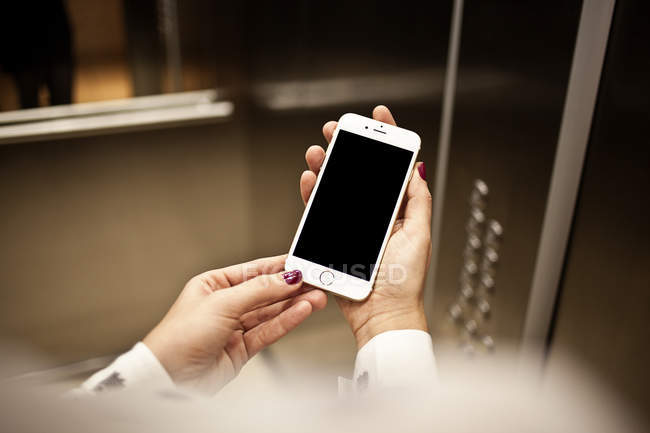 Hands holding smartphone — Stock Photo