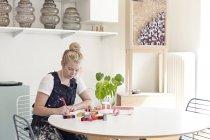 Female designer drawing furniture sketch — Stock Photo