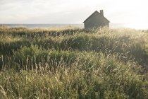Small house by seaside — Stock Photo