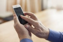 Close-up of hands of senior man holding phone — Stock Photo