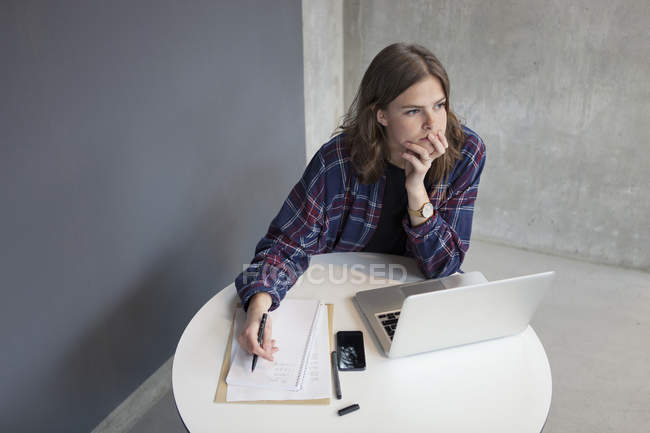 Brunette woman thought about something — Stock Photo