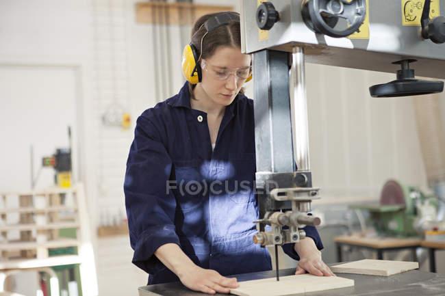Woman working with machine equipment — Stock Photo