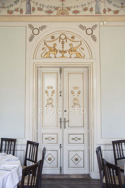 White door in dining room — Stock Photo