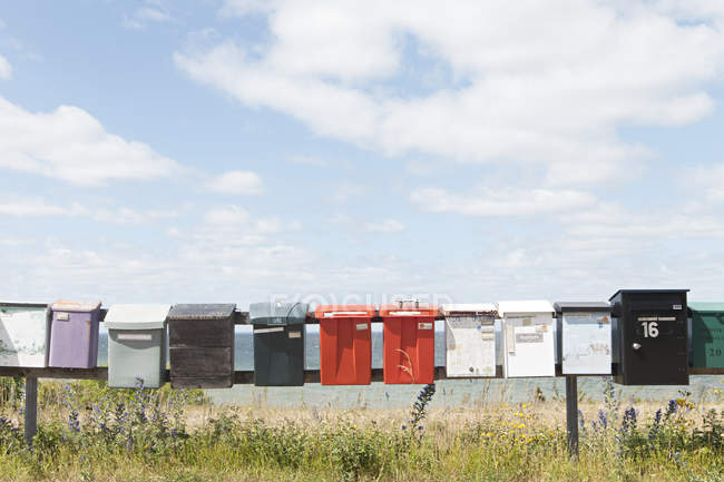 Mailboxes on poles in countryside — Stock Photo