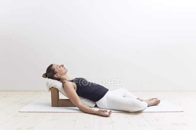 Woman resting in yoga posture — Stock Photo