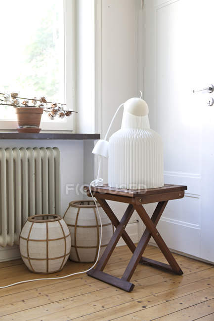 Chandeliers on stool and floor — Stock Photo