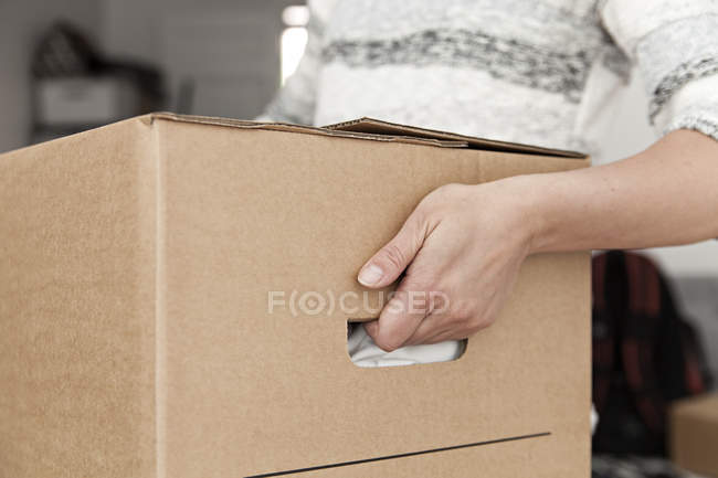 Woman holding cardboard box — Stock Photo