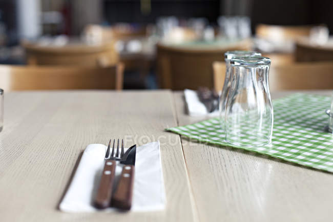 Close-up of cutlery on served restaurant table — Stock Photo