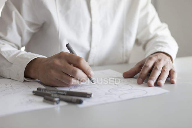 Close-up of male architect sketching at workplace — Stock Photo