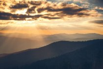 Cloudscape in mountains during sunset — Stock Photo
