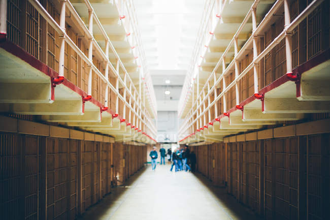 People walking in prison cells — Stock Photo