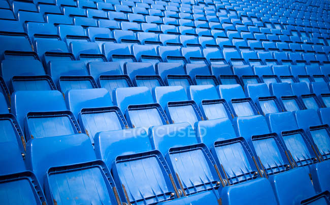 Empty blue bleachers on stadium — Stock Photo
