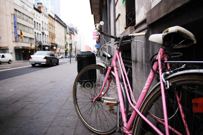 Bicycle parked on street — Stock Photo