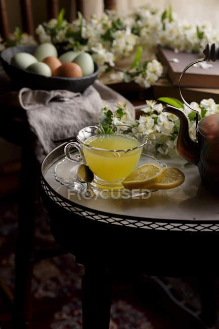 Ginger lemon honey tea in cup — Stock Photo