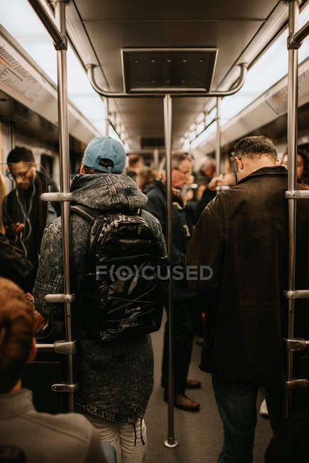 Urban scene with people in metro wagon — Stock Photo
