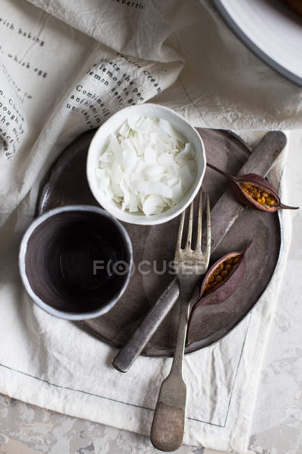 Cup with coconut flakes — Stock Photo