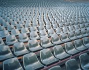 Perspective view of rows of plastic stadium seats — Stock Photo