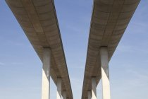 Concrete overpasses over blue sky on background — Stock Photo