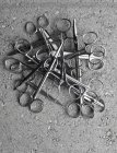 Pile of surgical scissors on cement surface — Stock Photo