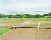 Running track and playing field on sunny day — Stock Photo