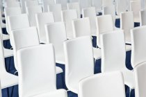 Full frame shot of white chairs in row — Stock Photo