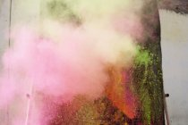 Full frame shot of colorful powder paint spraying — Stock Photo