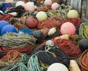 Stacked fishing buoys and ropes — Stock Photo