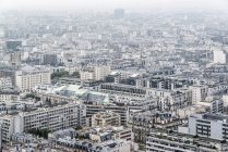 Aerial view of residential district of Paris in foggy weather — Stock Photo